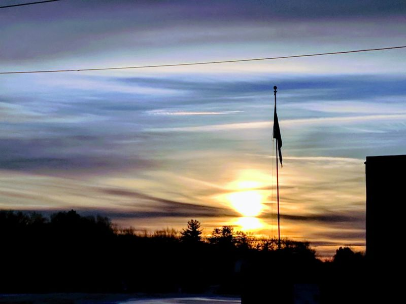 incredible sunrise, so whispy and reflective ! Sunrise Beautiful Sky Whispy Clouds Amazing Colors Sky Bright Winter Morning No Wind Snow Sun Clouds Blue Orange Sky Flag Silhouette Cloud - Sky No People Sky Technology Nature