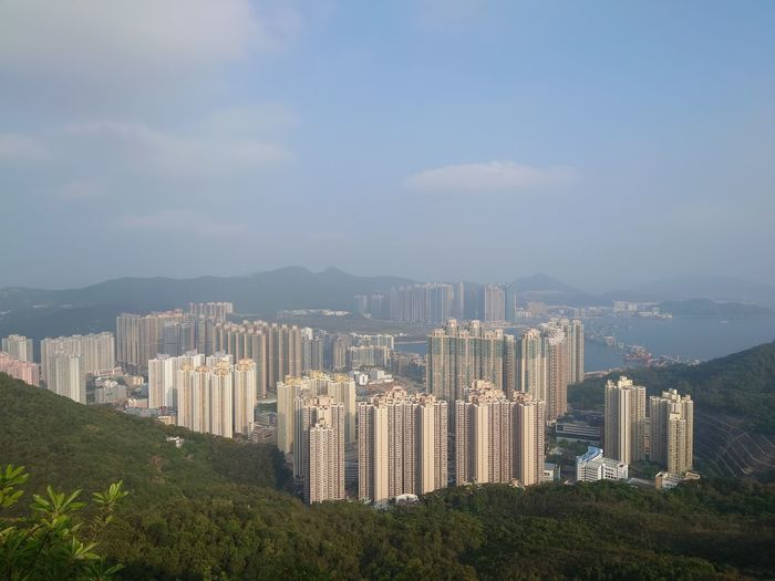 Panoramic view of buildings in city against sky