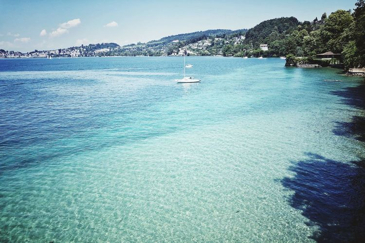 Photooftheday Naturephotography Photographer Photography Picoftheday Mountains Boats And Water Vierwaldstättersee Lake View Water Beauty In Nature Sky Sea Day Scenics - Nature Nature Tranquil Scene Tranquility No People Waterfront Idyllic Transportation Beach Blue Outdoors Nautical Vessel