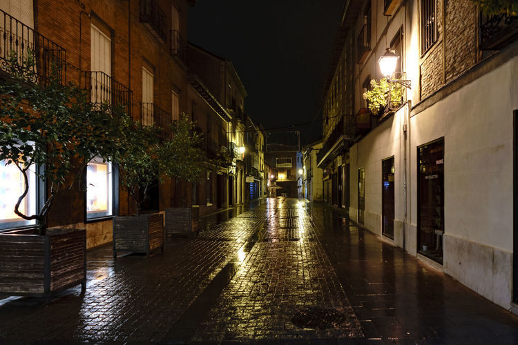 Photos of the city of Alcala de Henares on a rainy night Architecture Cervantes Nightphotography Rainy Days Water Reflections Architecture Baroque Style Building Exterior Built Structure City Illuminated Light And Shadow Night No People Outdoors Streetphotography The Way Forward Walkway