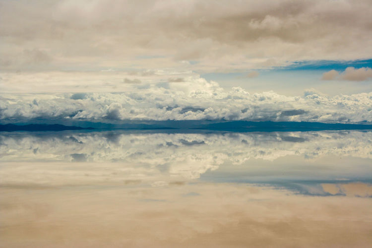 Salar De Uyuni Aerial View Beauty In Nature Calm Cloud Cloud - Sky Cloudscape Countryside Day Idyllic Majestic Nature No People Non-urban Scene Reflection Remote Scenics Sea Seascape Sky Standing Water Tranquil Scene Tranquility Vacations Water Waterfront