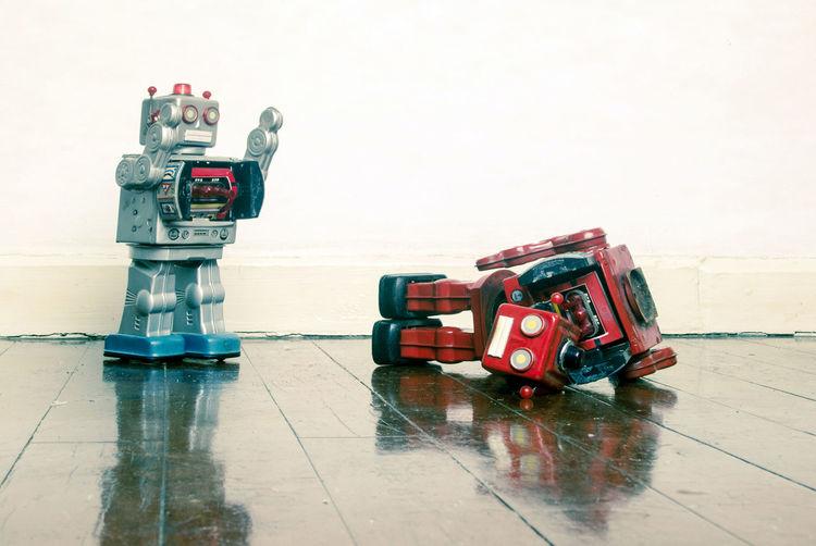 Toys on wet floor against sky in city