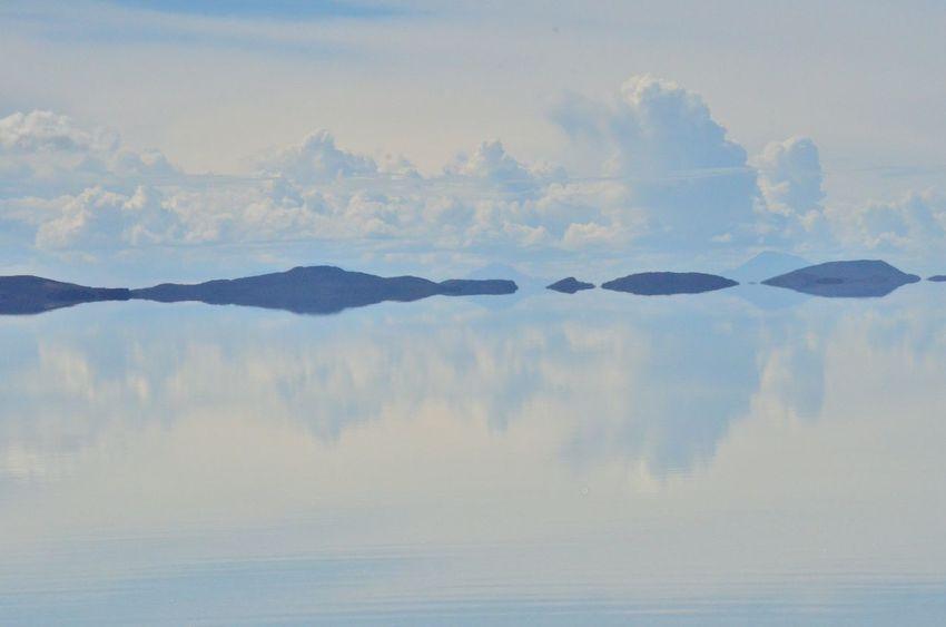 Salar de Uyuni filled with water Scenics Beauty In Nature Sky Nature Cloud - Sky Landscape No People Silence Water Outdoors Salar Uyuni Reflection Reflection Lake Bolivia Miles Away