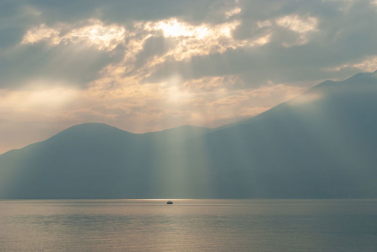 Sea Water Sunset Nature Sky Fog Outdoors Boat Tranquility Sunrays Lago Di Garda Mountain Waterfront Beauty In Nature No People Idyllic Tranquil Scene Mountain Range Non-urban Scene Cloud - Sky Scenics - Nature Italy