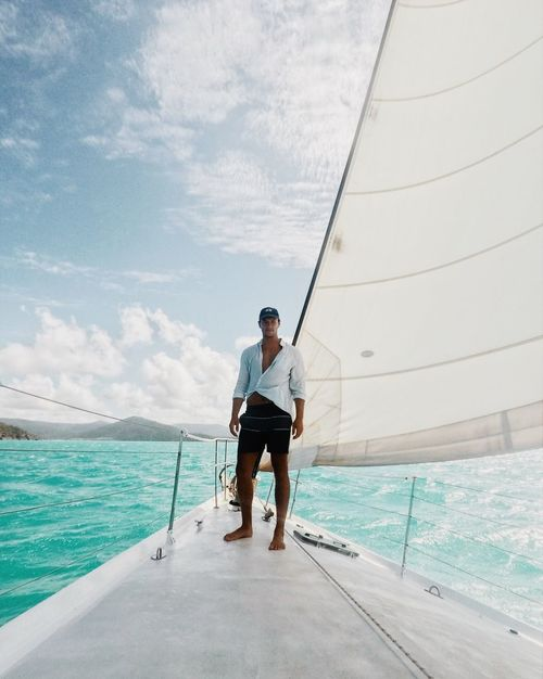 Australia EyeEm Selects Sea One Person Nautical Vessel Sky Men One Man Only Yacht Water Only Men Luxury Leisure Activity Full Length Vacations Sailing Relaxation Mode Of Transport Real People Standing Outdoors Adults Only