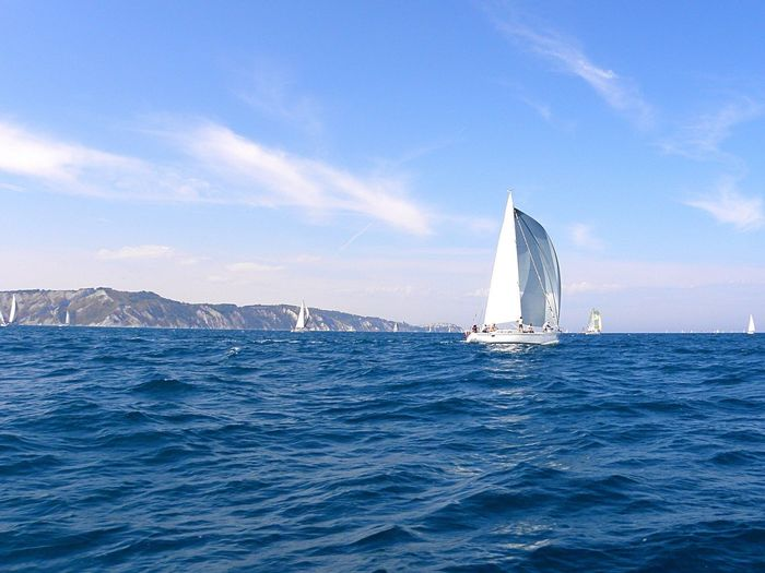 Sea Sailboat Water Sailing Nautical Vessel Sunlight Nature Sky Transportation Outdoors Vacations Beauty In Nature Yacht Day No People Horizon Over Water Scenics Sailing Ship Yachting Blue Blue Wave White And Blue Investing In Quality Of Life
