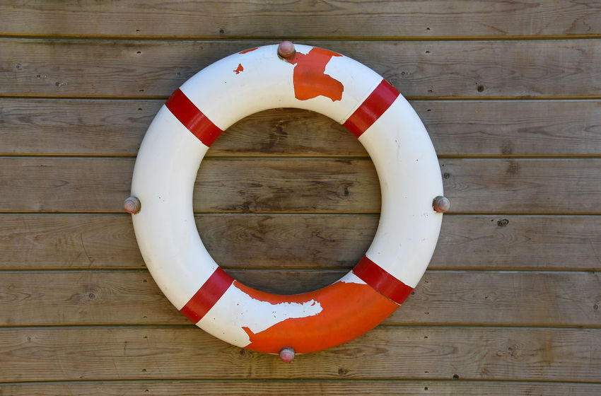 Life Buoy Circle Drowning Painted Red Beach Hut Day Full Frame Geometric Shape Hanging Hut Life Belt Life Buoy No People Outdoors Protection Round Save Life Seaside Shape Striped Tube Wall - Building Feature White Wooden