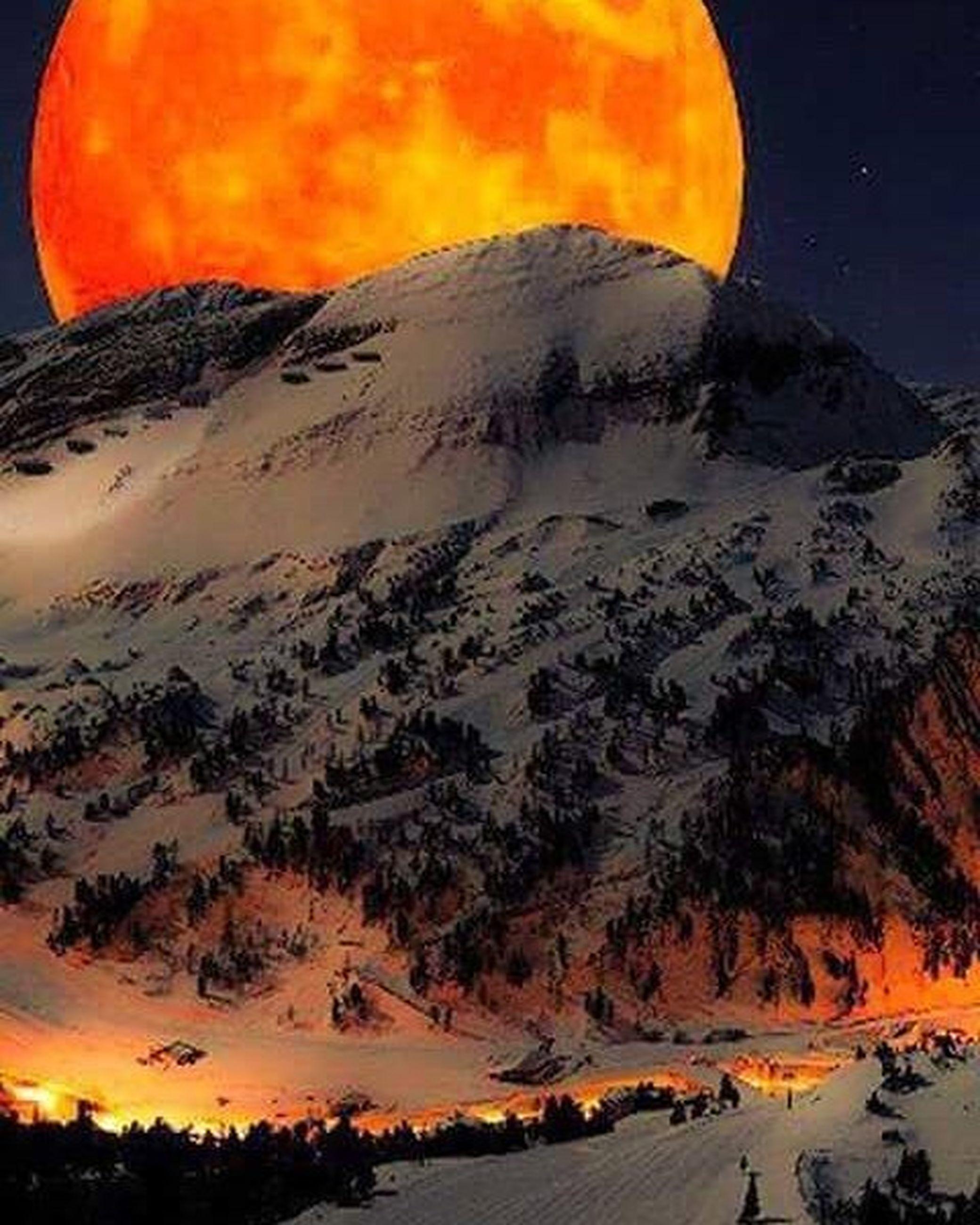sunset, orange color, scenics, tranquil scene, tranquility, beauty in nature, mountain, sky, nature, idyllic, landscape, season, winter, non-urban scene, snow, outdoors, majestic, mountain range, cold temperature, dusk