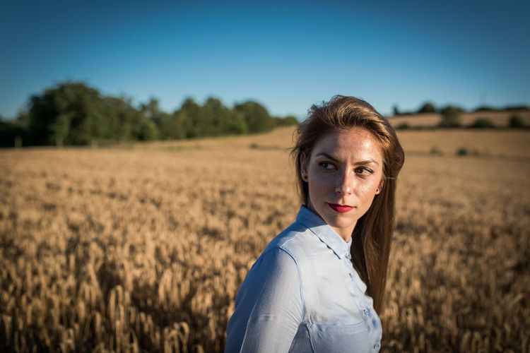 Beautiful Woman Looking Away While Wheat Field