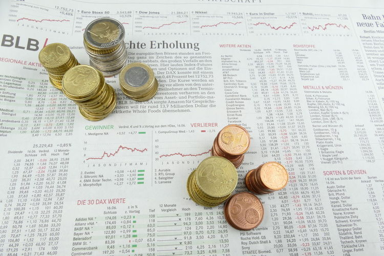 Budget Business Chart Coin Currency Day Finance Financial Figures Finanzen Gold Colored Graph Indoors  Investment Münzen Newspaper No People Paper Savings Stock Market And Exchange Wealth Wirtschaft