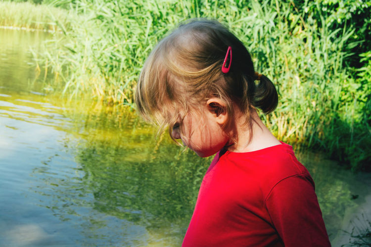 Portrait of a pensive, attentive child. recreation and observation in nature