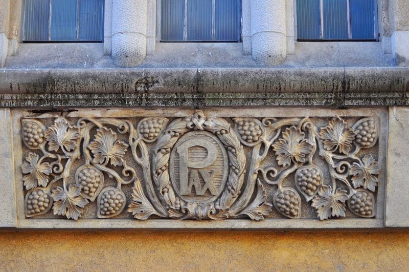 Low angle view of ornate window on building