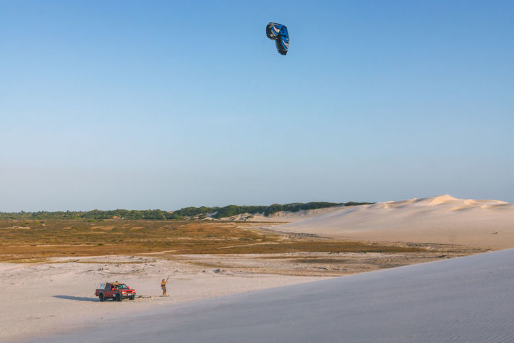 We met this guy on our way home and he invited us to for some free kite sandboarding in the sandy national park of Lencois Maranhenses. Beach Beauty In Nature Car Clear Sky Day Kite Leisure Activity Men Nature Outdoors People Real People Remote Sand Sand Dune Sea Sky Sport Sports Tranquil Scene Tranquility Travel Travel Destinations Travel Photography Traveling The Great Outdoors - 2017 EyeEm Awards EyeEmNewHere Sommergefühle Lost In The Landscape Connected By Travel Focus On The Story Visual Creativity The Great Outdoors - 2018 EyeEm Awards The Traveler - 2018 EyeEm Awards Summer Sports