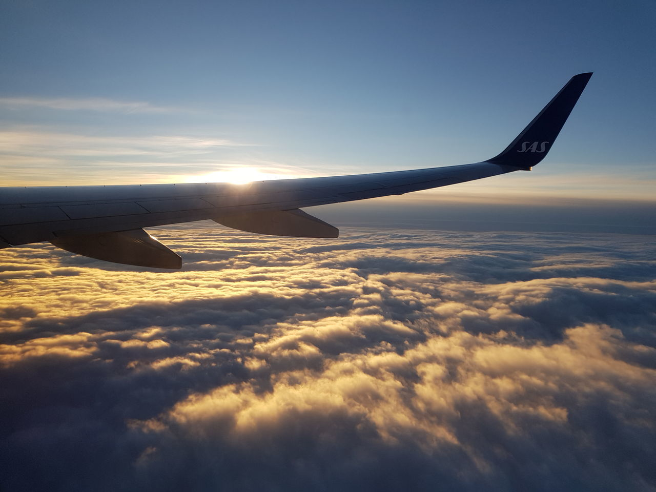 air vehicle, airplane, cloud - sky, sky, mode of transportation, sunset, transportation, flying, beauty in nature, scenics - nature, mid-air, aircraft wing, nature, travel, cloudscape, no people, public transportation, outdoors, orange color, idyllic, aerospace industry