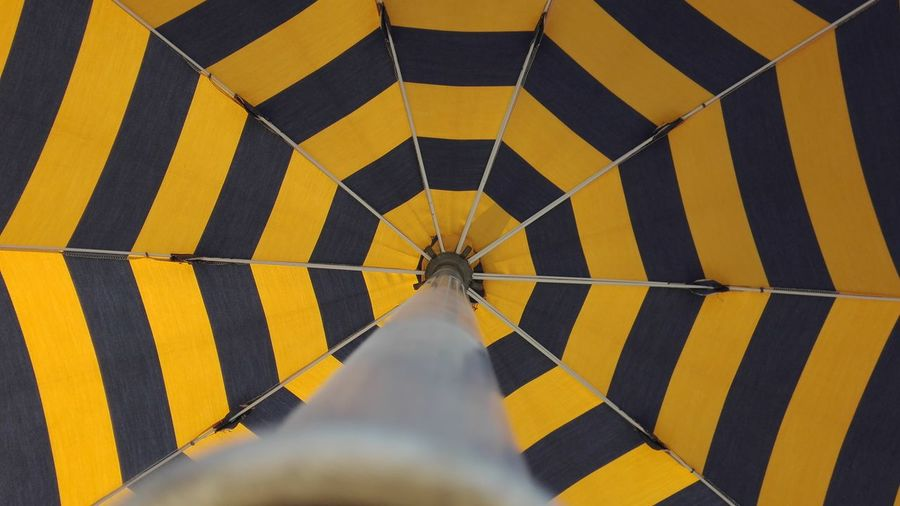 Low section of person on yellow umbrella
