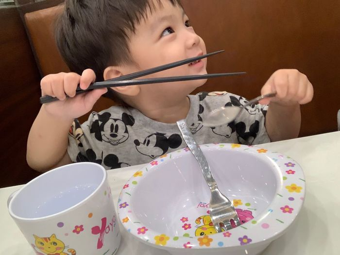 Childhood Child One Person Real People Indoors  Holding Lifestyles Innocence Food And Drink Food Leisure Activity Front View Girls Cute Table Women Females Males  Temptation