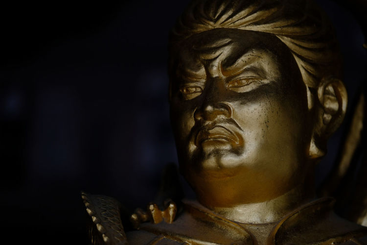 Close-Up Of Gold Statue