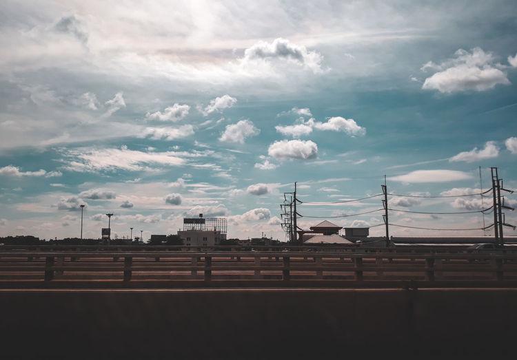 Silhouette bridge against sky in city