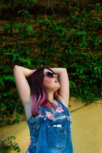 Green Wall Space Young Adult Beauty Portrait One Woman Only Sunglasses Fashion Outdoors Long Hair City Paint The Town Yellow