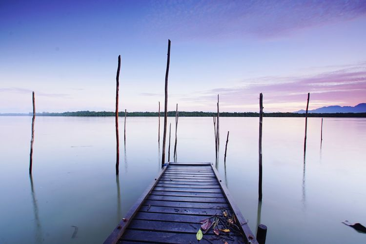 jetty and river Jetty EyeEmNewHere EyeEm Selects Peaceful Landscape Water Scenics Tranquility Tranquil Scene Lake Landscape Reflection Pier Wood - Material No People Travel Destinations Outdoors Beach Beauty In Nature Wooden Post Nature Day Horizon Over Water Sky