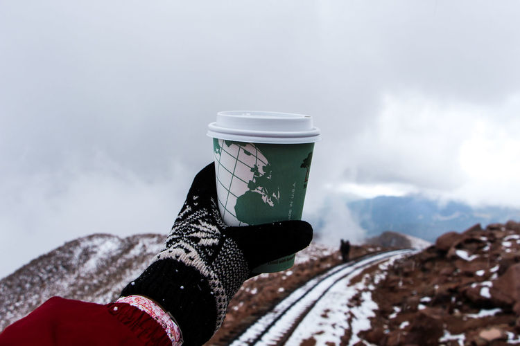Pikes peak, USA Adventure Coffee Coffee Break Coffee Time Cold Cold Temperature Colorado Springs Freshness Glove Ice Age Hot Hot Drinks Man Made Object Mountain Person Personal Perspective Pikes Peak Pikes Peak Summit Sky Tea Tranquility Travel Destinations Traveling USA A Bird's Eye View