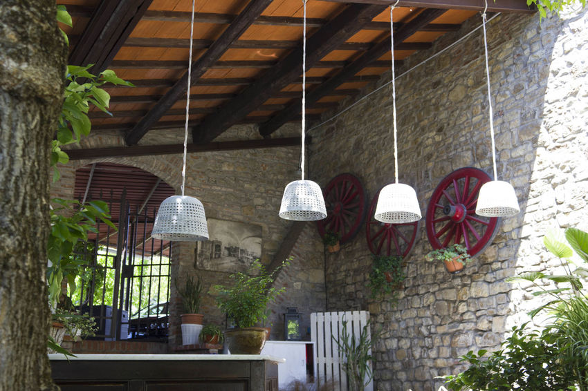 FLORENCE, ITALY -MAY 21 2016: Traditional bar countertop in the outdoors of a rustic restaurant with exposed beams near Florence, Italy Bar Countertop Bistro Countertop Day Exposed Beams Florentine Interiors Outdoor Outdoors Restaurant Rural Rustic Set Stone Wall Taverna Tuscany Wheels