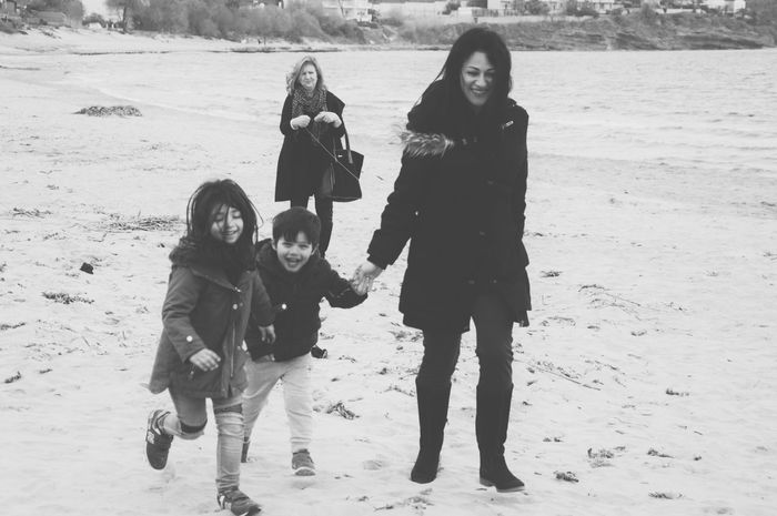 Blackandwhite Family Power Childhood Happiness Family Togetherness Cheerful Simple Things In Life Childhood Memories Black And White Kids Being Kids Children Photography Motherhood Family Time Family Matters Enjoying Life On The Beach Having Fun Leisure Activity Full Length Women Around The World Connected By Travel