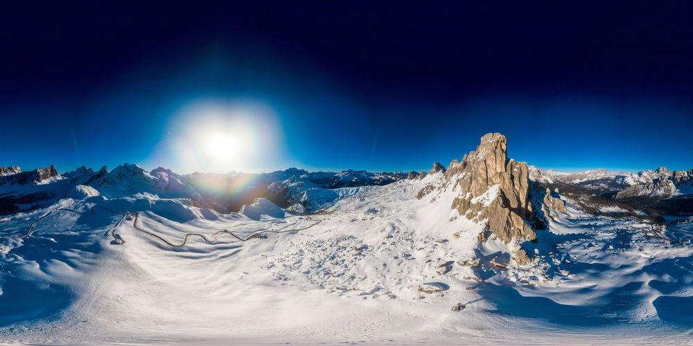 360 panoramic view of ra gusela -passo giau- over a blue sky, near cortina d'ampezzo, italy