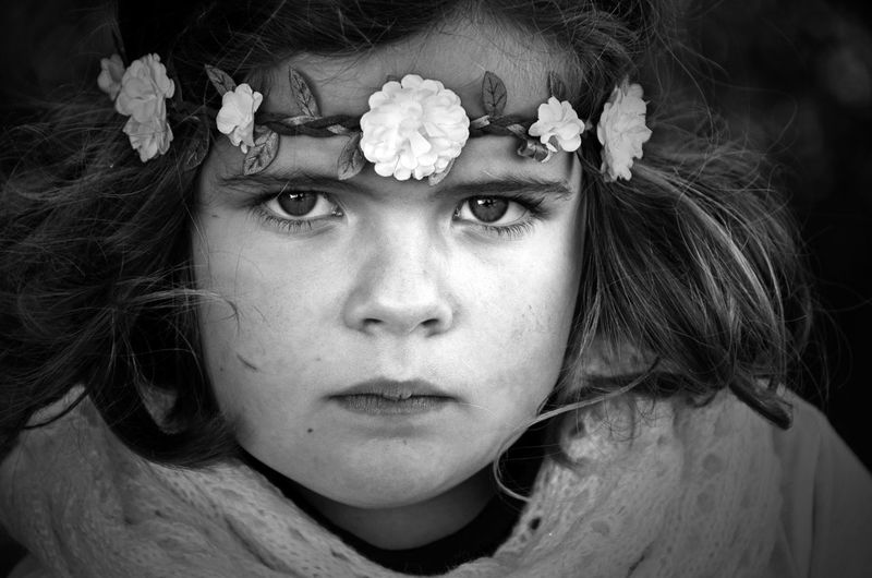 Close-up portrait of girl with flower headband