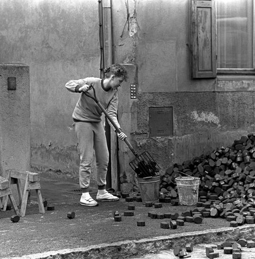 Dresden 1988 1988 DDR DDR Time Dresden Dresden-Neustadt GDR Woman Architecture Building Exterior Casual Clothing Coals Day Full Length Germany History Holding Lifestyles Old Buildings One Person Outdoors Real People Shovelling Standing Working