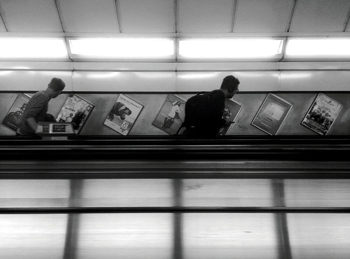 London Underground Indoors  Wireless Technology Passenger Communication Commuter Men People Subway Train Public Transportation Technology One Person Adult Adults Only Day