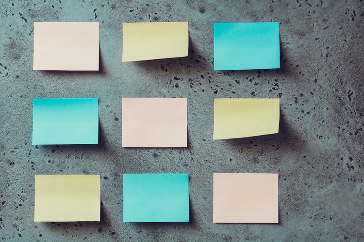 Close-up of sticky notes on wall