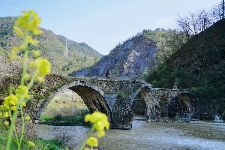 River Traveling In China Landscape Bridge Bridge - Man Made Structure Nature Water Sky Tree Beauty In Nature Plant Mountain Architecture Built Structure Yellow Outdoors