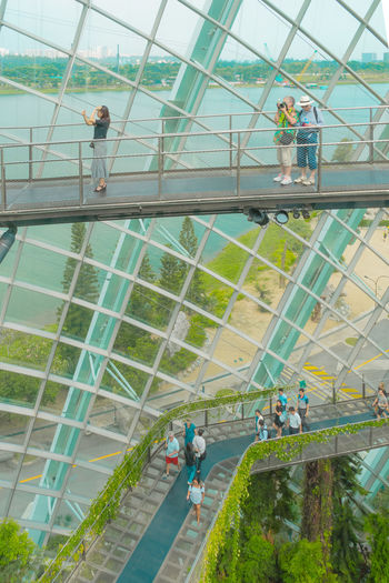 High angle view of people walking on glass
