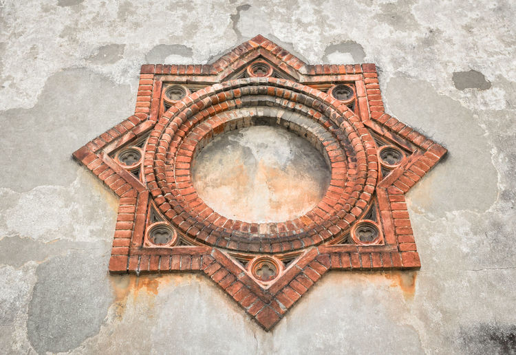 Symbol of Crespi d'Adda in Capriate San Gervasio, Bergamo. Lombardy / Italy. Adda Ancient Architecture Bergamo Circle City Company Crespi Family Industrial Industry Worker Cotton Decoration Detail Eight Emblem  Factory Heritage Historic Italy Landmark Maddalena Mill Monument