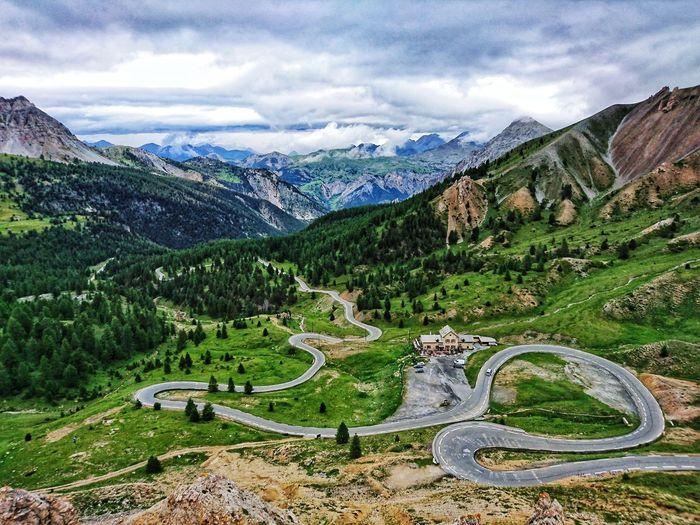 """La vue imprenable que les cyclistes du monde entier vont prendre. """"Le tour de France"""" passe toujours par Le Galibier... S'asseoir ici et profiter... (Alpes-Maritimes, France) Mountain Sky Mountain Range Landscape Cloud - Sky Mountain Road Winding Road Rocky Mountains Mountain Peak Valley Physical Geography Rock Formation Stay Out"""