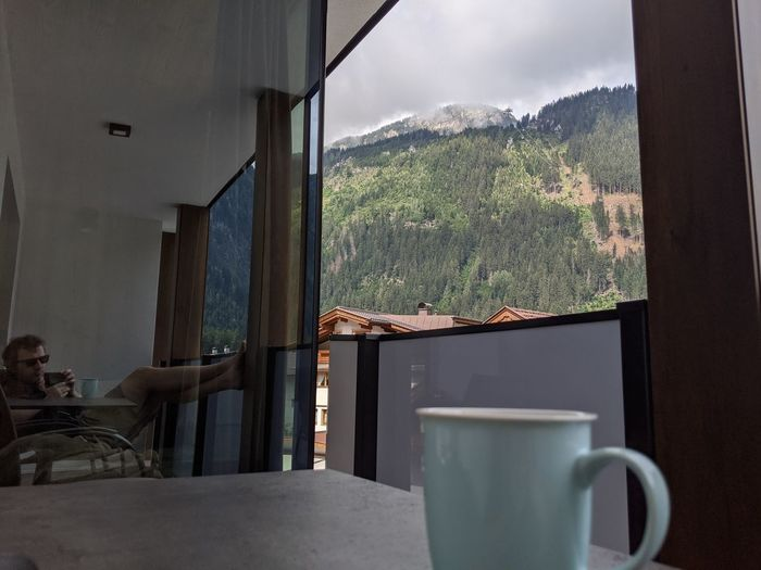 Coffee cup on table by window