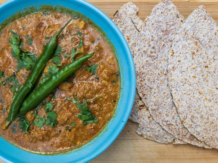 Chicken Curry Roti Asian Food Bowl Chapati Chilli Cilantro Coriander Coriander Seeds Cumin Directly Above Food Healthy Eating Herb High Angle View Indian Food No People Spice Tomato Turmeric