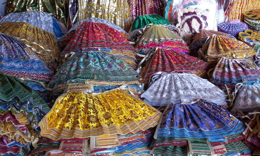 High angle view of colorful skirts for sale at market stall