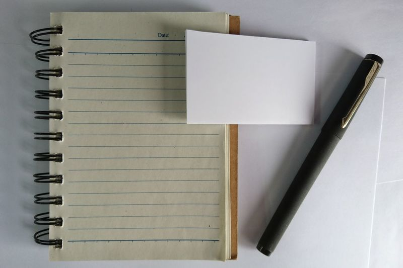 High angle view of pen and book on table