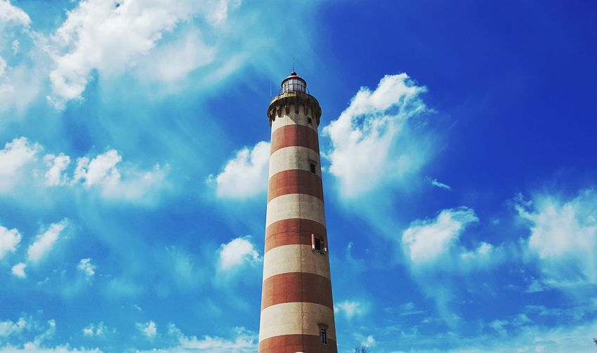 Sky Cloud - Sky Day Blue Low Angle View Outdoors Lighthouse Smoke Stack No People Architecture Politics And Government Aveiro Portugal Praia Da Barra Farol Colours Red White Clouds Blue Sky My View Walking Around