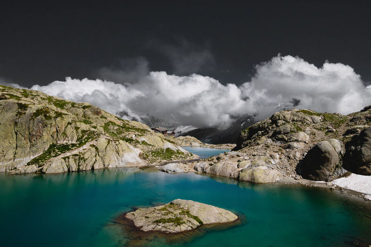 Panoramic view of lake and rocks against sky