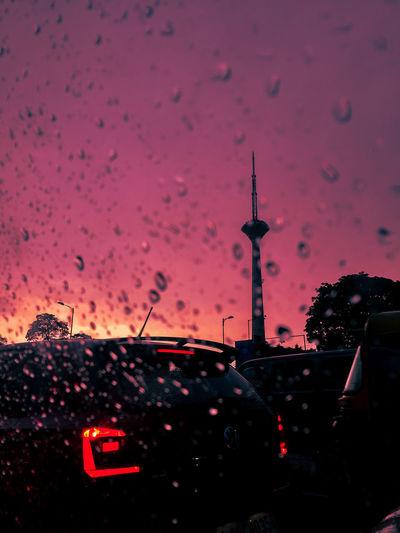 Cars on wet windshield during rainy season