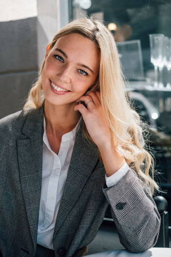 Happy smiling business woman Portrait Happiness Beautiful Woman Smiling Real People Front View Beauty Young Adult Looking At Camera One Person Young Women Women Focus On Foreground Hairstyle Business Hair Blond Hair Well Dressed Proffesional Modern The Modern Professional