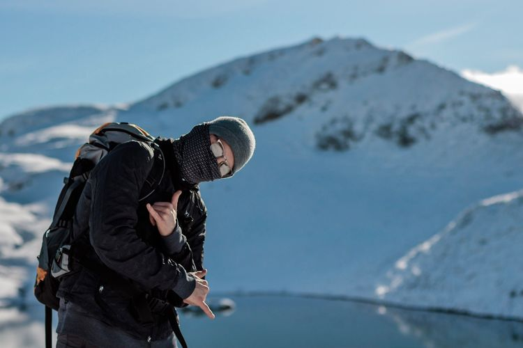 Man Standing Against Snowcapped Mountain