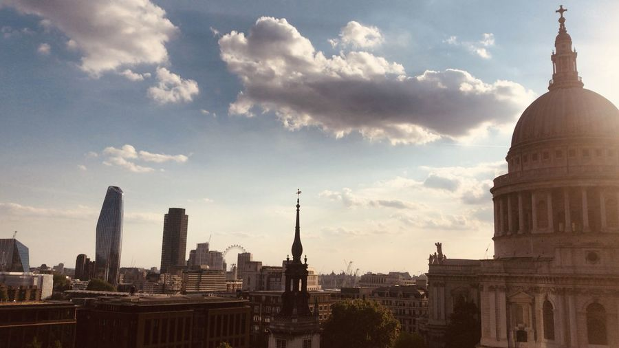 Panoramic view of buildings against sky in city