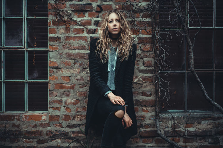 Young blonde girl in front of an old brick wall with windows aside Blonde Young Portrait Woman Girl Model Glamour People City Youth Culture Hipster - Person Beautiful People One Person Young Adult Pretty Beauty