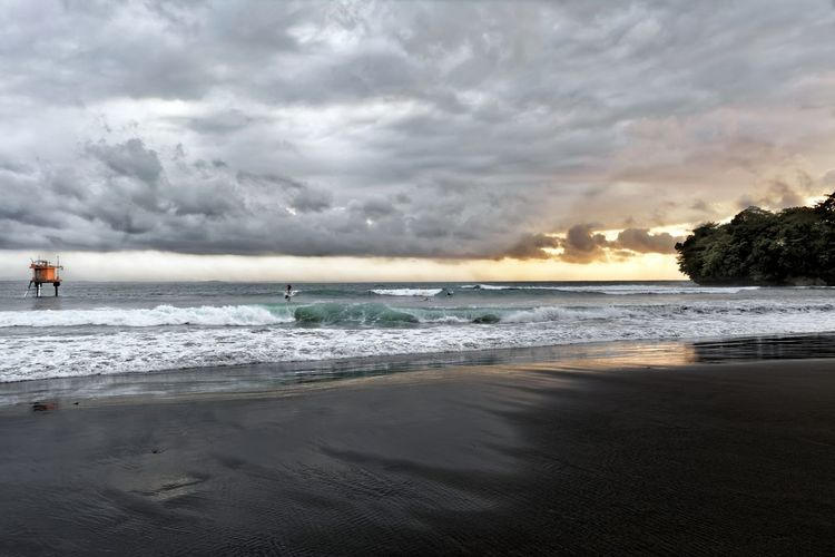 First for second time ... beautiful Bandung Shooter Indonesian Shooter Sea Water Beach Cloud - Sky Sky Land Sand Wave Beauty In Nature Nature Motion Scenics - Nature Horizon Over Water Horizon Sport Aquatic Sport People Surfing Sunset Outdoors A New Perspective On Life Capture Tomorrow 2018 In One Photograph