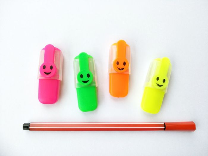 Colors and design of marker pens on white background in stationary decorations concept Art Arrangement Design Decoration Marker Pens Stationary Close Up Smile White Backg Indoor Space Colourful Yellow Green Pink Orange EyeEm Selects High Angle View Multi Colored White Background Indoors  No People Day