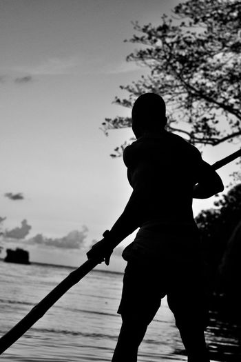 Rafting on the Blue Lagoon One Person Real People Silhouette Sky Water Standing Men Outdoors Leisure Activity Day Nature Blackandwhite 876EyeEm Shadows & Lights #melanin #black Magic